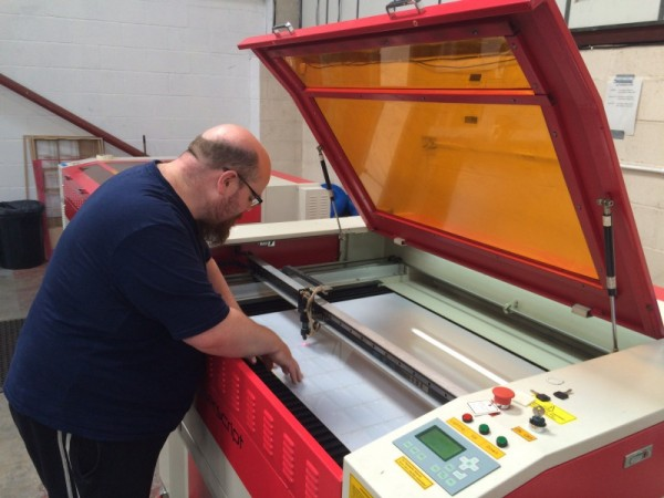 Paul checking quality and accuracy of cutting - QC is done with visual inspection.